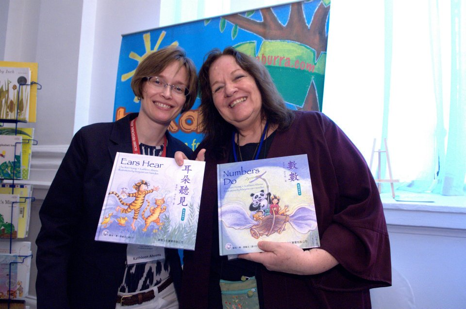Kathleen Ahrens (Advisory Board member and the International Regional Advisor Chairperson of the SCBWI) and Marjorie van Heerden (co-Ra SCBWI (SA) at the launch of Numbers Do and Ears Hear during the 2012 AFCC (Asian Festival of Children's Content) Conference in Singapore.  These two bilingual books for babies and toddlers in English and Chinese were written by Chu-Ren Huang & Kathleen Ahrens and illustrated by Marjorie Van Heerden. Published bu Sun Ya Publishers (Hong Kong, China) in 2012