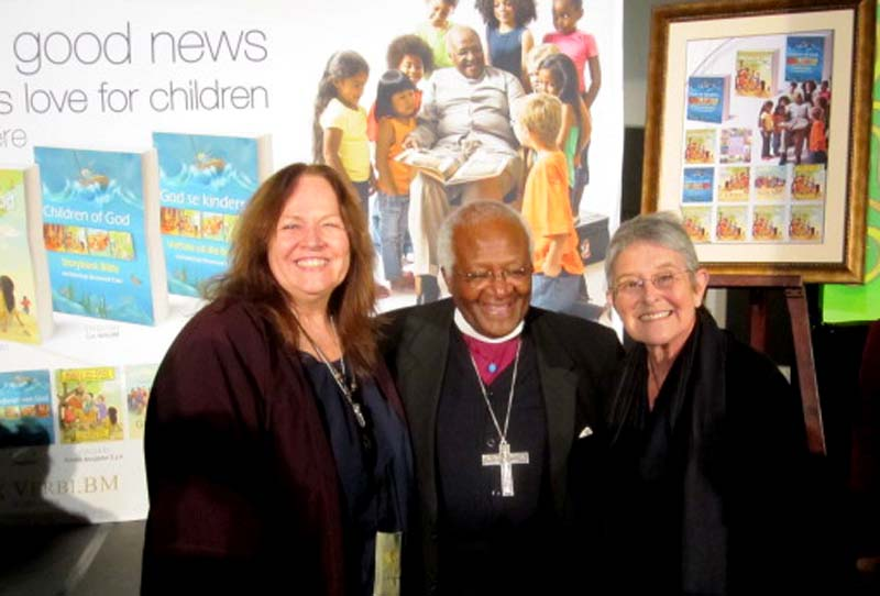 Marjorie van Heerden (co-Ra SCBWI (SA), Archbishop Desmond Tutu, the former Archbishop of Cape Town and Paddy Bouma (Committee Member SCBWI (SA)) at the launch of  the book, Children of God Storybook Bible by Archbishop Desmond Tutu published by Zondervan Publishers in 2010. The book was illustrated by 20 illustrators all over the world. Marjorie van Heerden and Paddy Bouma were the two South African illustrators that commissioned to each illustrated two stories.